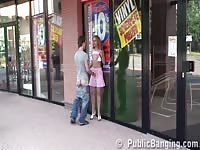appealing teenage  doll tiresome having hook-up tiring in public by a store window Thumb