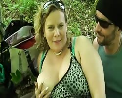 Brutal sex for a chubby milf in the woods Thumb