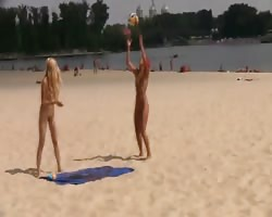 Hot teen nudists play at beach. Thumb