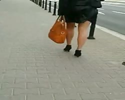 impartial #81 woman with benign legs in mini skirt and high heels Thumb