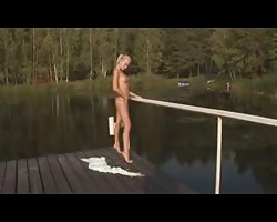 Nude Beach - molten Blond wanking on Pier Thumb