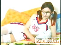 Cheerleader female plays with her honeypot Thumb