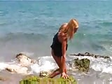 Nude Beach - chesty Blond Poses on the Shore Thumb