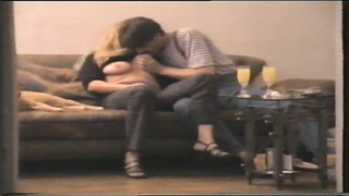 Amateur couple fooling on the couch Thumb