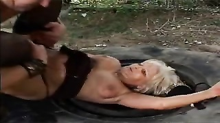 Guy fucks and facializes horny slut on an old tire on the ground Thumb