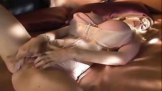milf huge counterfeit juggs plays with her dildo Thumb