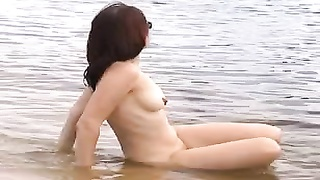 delicious nude female on the beach Thumb