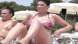 brief HAIRED milf showing gigantic knockers AT THE BEACH. Thumb