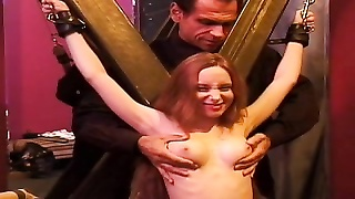 Slave with a nice rack, bound, while her tits are teased Thumb