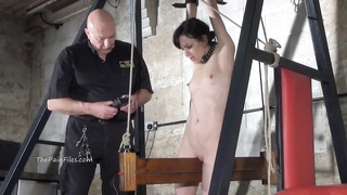 low electro bdsm and wooden plot restrain bondage  of slave Elis Thumb