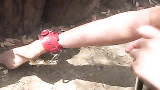 Mistress playing with her slave outdoors Thumb