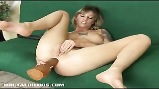 Tatted up Tricia swallowing a big fake penis  with her ass Thumb