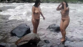 2 indian frail womens dull bathing in river bare Thumb