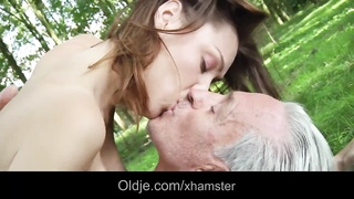 ancient hippie guy smashes a hottie young female in the woods Thumb