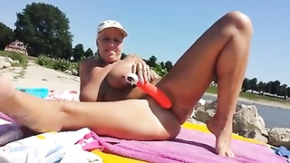 Nude Beach - large hooter obsolete Blond dildo Thumb