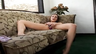 Playing with her fake penis Thumb