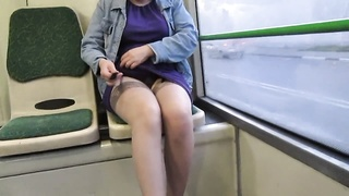 damsel checking stockings and suspenders in a bus Thumb