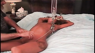 youthful brunette's shaven pussy is tortured on bed by mature sub  master dude Thumb