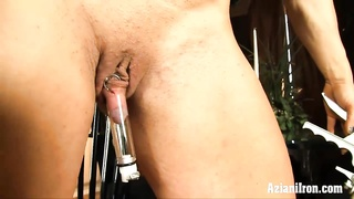 Aziani metal  buff chic uses pleasure button pump on her big clitoris Thumb
