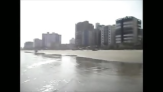 spouse  filming his wifey  on the beach Thumb