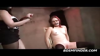 Femdom dominates A Redhead In Glasses Thumb