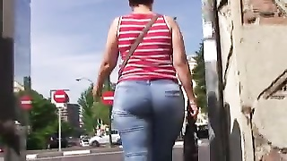 Spanish impartial arse in blue denims Thumb