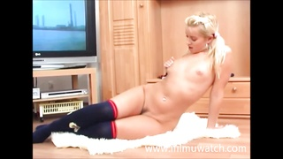 Norwegian teenage  jerking in front of the television. Thumb