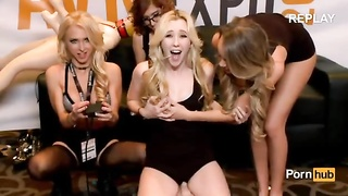 Samantha Rone squeals railing  the sybian saddle  in the PornHub booth at 2015 AVN Thumb
