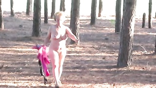outmoded Nude woman SS undresses in Wooded area Thumb