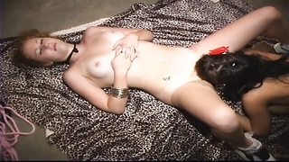 young whore gargles  a large belt dick weared by mistress Thumb