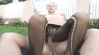 Pregnant yellow-haired in fishnets penetrated outdoor Thumb