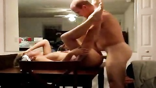 penetrating his wife on the dining room table Thumb