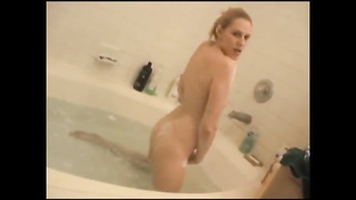 Soapy young body in the bathtub Thumb