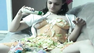 woman makes a salad on her belly and boobies Thumb