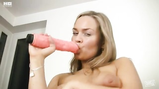 Voluptuous girl plays with a big dildo Thumb