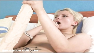 blondy Russian fills her taut  fuckbox with a big brutal fake penis Thumb