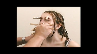 Both chick with clothes pins on her face Thumb