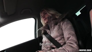 damsel in tight turtleneck is beautiful in the car Thumb