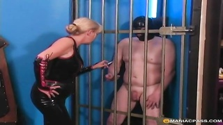 Saucy mummy  dominatrix cageds her masked hookup sub  to taunt  him Thumb