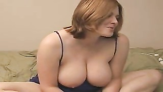 plump dame generous with big jugs on camera Thumb