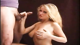 doll  with oiled up jugs gives a handjob Thumb