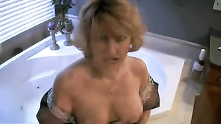 French maid milf sucks schlong in bathroom Thumb