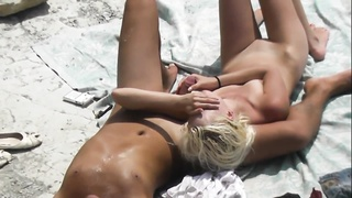 Voyeur. Slim blonde Jerks and her boyfriend at public beach Thumb