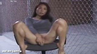Asian girl doing herself on a chair Thumb
