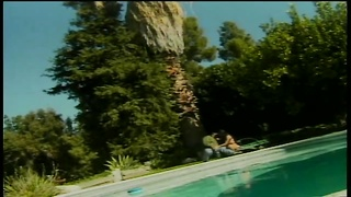 Lithe young hooker takes care of big black cock by the pool. Thumb