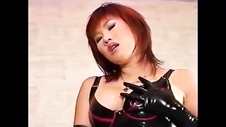 Japanese Domme in Latex Punishes Her Male Slave Thumb
