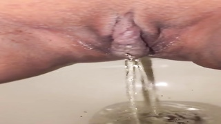 Peeing and dripping cum in a public toilet Thumb