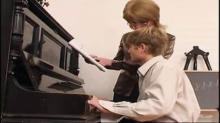 Older piano teacher dominates her student Thumb