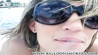 Hot teen Cheyenne smoking a cigarette on boat topless. Thumb