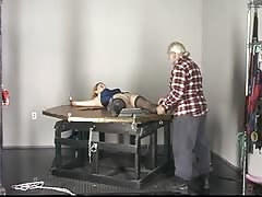 Blonde slave tastes her ass juices after sucking dildo on the punishment table Thumb